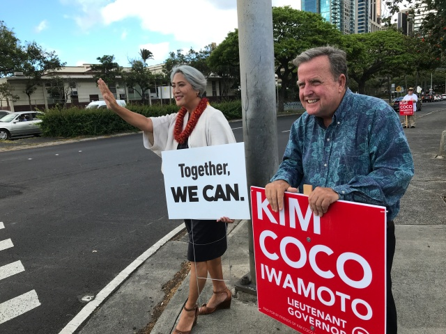 Kim and Hooser holding signs